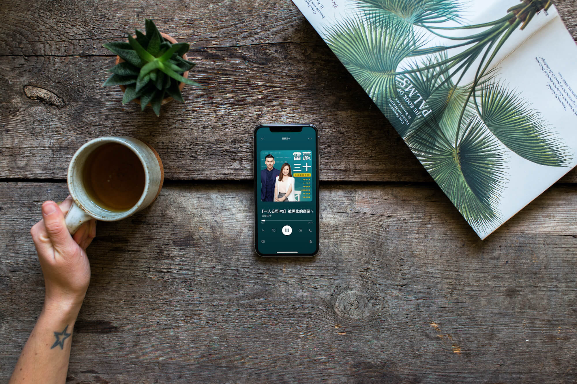 drinking tea over the iphone xs mockup and plants 3